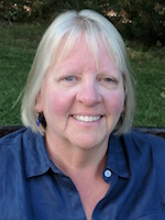 Image of Dean Laura Patey; a smiling woman in a blue shirt.